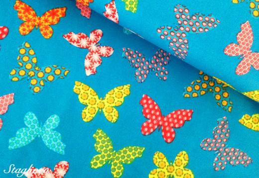 Wachstuch beschichteter Schmetterling-Stoff türkis